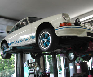 73 Porsche RSR clone, a track car, on the hoist at Van's Garage