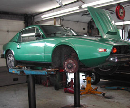 74 Saab Sonett 97 on the hoist at Van's Garage